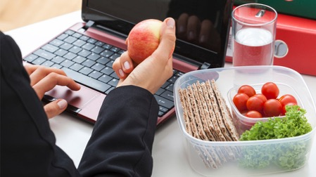 Eating at Your Desk? Follow Our Top Seven Food Safety Dos + Don'ts to Avoid Getting Sick